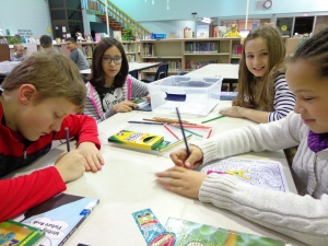 Students enjoying the fourth grade centers in the library.